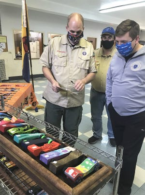 Cub Scout Pack 496 of Gardner hosted its long-awaited Pinewood Derby at Holy Spirit Church on Oct. 24. Judging the entries at the event are Den Leader John Saner, left, Den Leader Chris DePaola and state Rep. Jon Zlotnik.