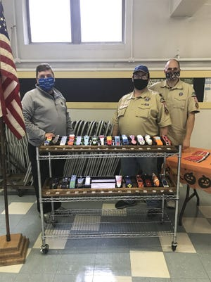 Cub Scout Pack 496 of Gardner hosted its long-awaited Pinewood Derby at Holy Spirit Church on Oct. 24. Judging the entries at the event are state Rep. Jon Zlotnik, left, Den Leader Chris DePaola and Den Leader John Saner.