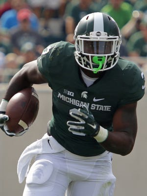 Michigan State's LJ Scott rushes against Central Michigan, Saturday, Sept. 26, 2015, in East Lansing.