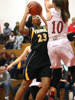 South Brunswick high school at Bishop Ahr girls basketball Saturday February 6, 2016 South Brunswick #23 Amber Brown shooting over Bishop Ahr #10 Sara Decker.  photo by Ed Pagliarini