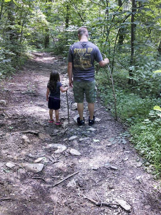 """Julie Deardorff of Dover submitted this photo to the YDR Nature and Scenery gallery. Deardorff writes: """"Our son, Jesse Deardorff and our Granddaughter, Taylor Crone started out walking together through the woods at our family cabin. After hiking for quite some distance she was tired so he carried her the rest of the way back to the cabin."""""""