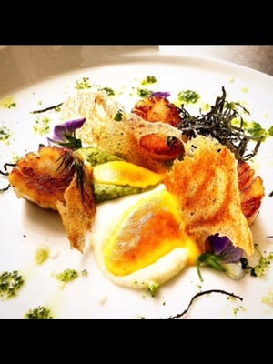 A scallops and sabian entree prepared by Logan Parker.