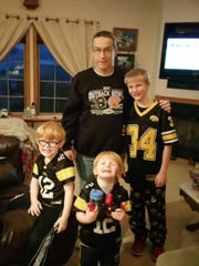 Papa Rick poses with his grandsons, including Jackson Johnston (standing).