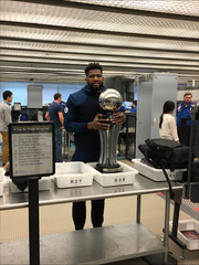 URI star Hassan Martin checking the Atlantic 10 trophy