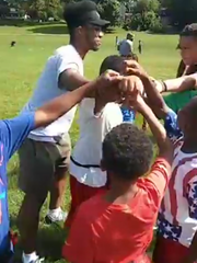 University of Michigan running back Chris Evans joins the huddle while playing flag football with the Michigan Patriots out of Battle Creek at Piper Park.