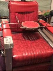 Eddie  Barrington's barber's chair.