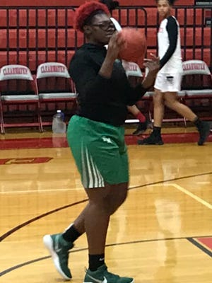Fort Myers freshman Center Chaniya Clark warms up prior to the 7A Region 3 final versus Clearwater. The Green Wave won the contest 71-37 to advance to the state Final Four .