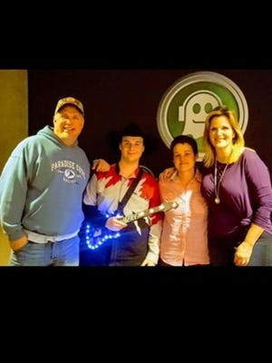 Andrew Bushey, 20, of Shiloh, will be at the Springmill Drive-In Saturday night for the Garth Brooks' concert on the big screen. He and his mother ,Angie Bushey, met Garth Brooks and his wif,e Trisha Yearwood, at a concert.