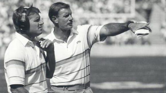 Then-UTEP head football coach Bob Stull, right, talks
