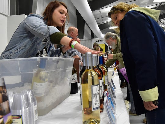 It's more than just brews at Roar Off the Shore Brewfest in Luxemburg -- Maryssa Paulsen of Parallel 44 Vineyard & Winery in Kewaunee talks about the winery's products with a guest at last year's brewfest. Six area wineries will be on hand for the event.