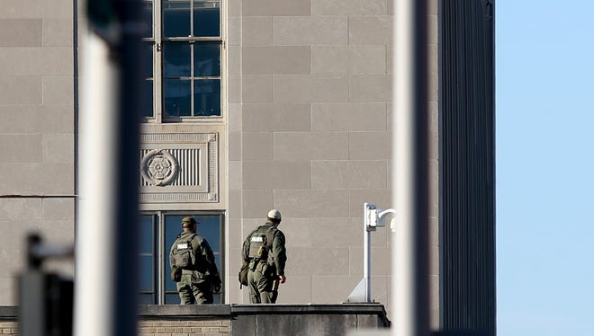 Law enforcement on top of the Federal Courthouse in Louisville, Kentucky. July 7, 2018