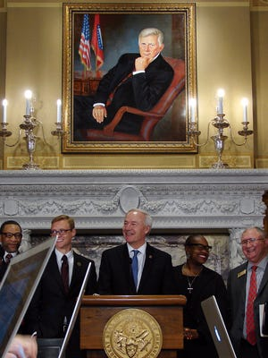 Arkansas Gov. Asa Hutchinson speaks in the governor's conference room inside the state Capitol in Little Rock, Tuesday, March 21, 2017, before signing a bill moving the state's Robert E. Lee holiday to October. Until Hutchison signed the bill, Arkansas had celebrated Lee and civil rights leader Martin Luther King Jr., on the same day in January. A portrait of Hutchinson's predecessor, Gov. Mike Beebe, hangs above the fireplace.