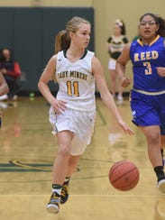 Kenna Holt dribbles the ball during a game against