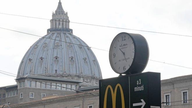 A sign points to a McDonald's restaurant near St Peter's Basilica in Rome.
