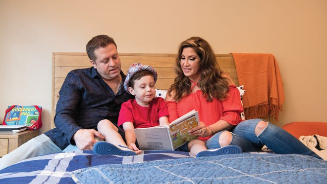 Jacqueline and Chris Laurita with their son Nicholas at their home in Franklin Lakes in July 2017.