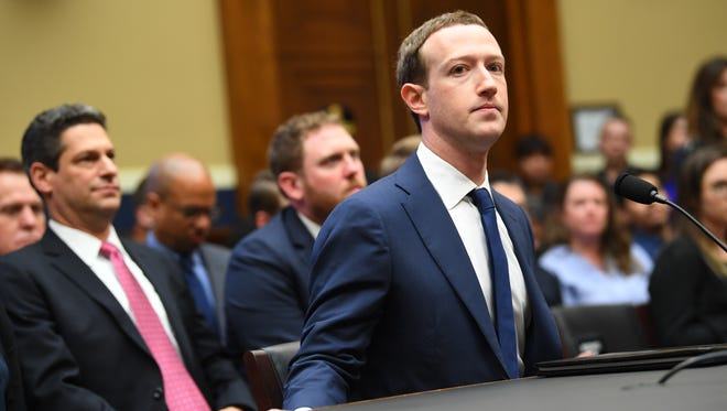 Facebook CEO Mark Zuckerberg arrives to testify before the House Energy and Commerce Committee on April 11, 2018.