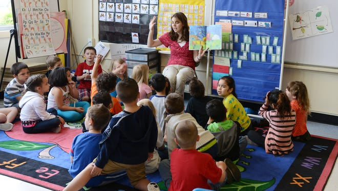 Charlotte Brulotte teaches a large kindergarten class at Auburn Elementary School on Thursday, May 22, 2014.