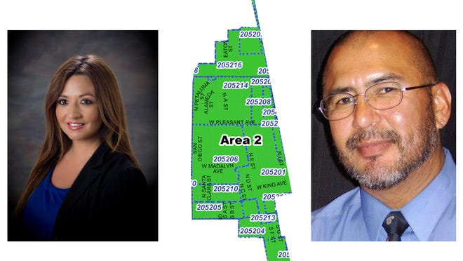 Maritsa Castellanoz Munoz, left and Art Cabello are shown with a map of Area 2.