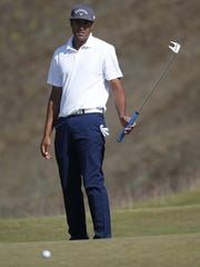 Tony Finau watches his putt on the ninth hole during the third round of the U.S. Open golf tournament at Chambers Bay on Saturday, June 20, 2015, in University Place, Wash.