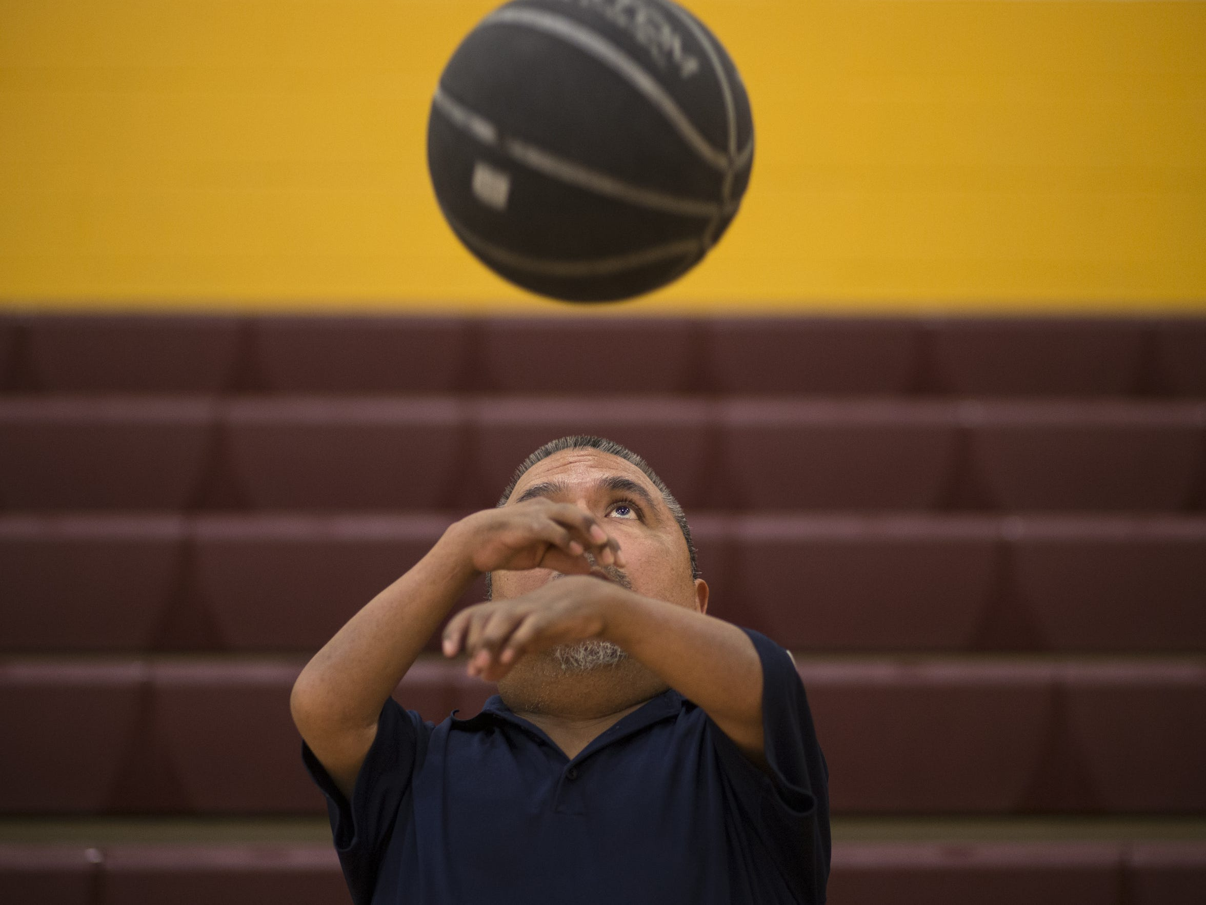 David Solano catches a basketball before the start