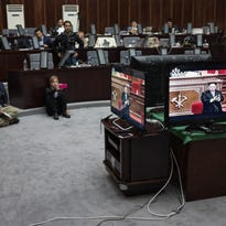 Hostesses watch a television broadcast showing a speech by North Korean leader Kim Jong Un at the 7th Workers' Party Congress at a restaurant at the Yanggakdo hotel in Pyongyang on May 6, 2016.