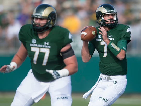 Center Jake Bennett protects CSU quarterback Nick Stevens during a 2016 game against Fresno State at Hughes Stadium. Bennett is one of three former CSU players in the new Alliance of American Football, which begins its inaugural season this weekend.