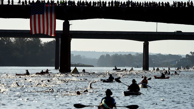 Ironman swimmers make their way down the Savannah River during the Ironman 70.3 in Augusta Ga., Sunday morning September 23, 2018.