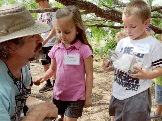Children show off their insect habitats  at River Bend Nature Center's Critter Camp. s.