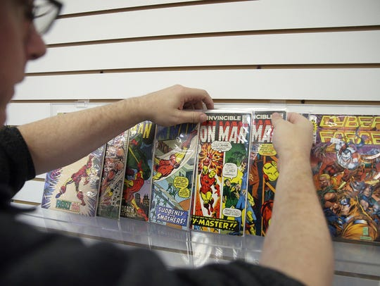 The Comics Keep owner Shawn Fellows with some classic