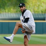 Chicago Bulls first-round draft pick Denzel Valentine plays with the ball before throwing out a ceremonial first pitch before a baseball game between the Minnesota Twins and the Chicago White Sox in Chicago, Wednesday, June 29, 2016.