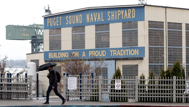 The Puget Sound Naval Shipyard looms in the background next to the Bremerton ferry terminal on Wednesday.