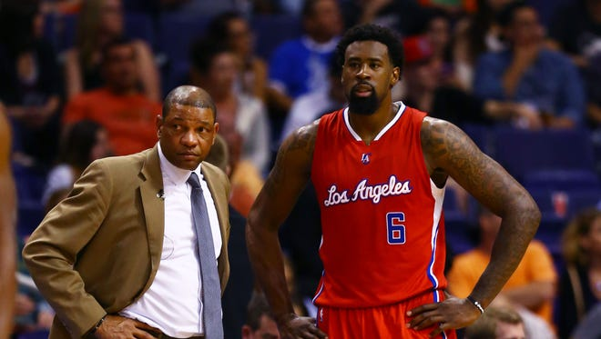 Los Angeles Clippers center DeAndre Jordan (6) talks to head coach Doc Rivers against the Phoenix Suns at US Airways Center.