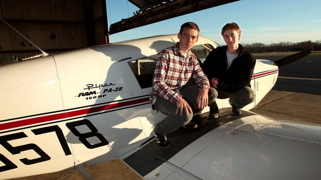 Mendham High School students Mark Brown and Seth Kimmel, who just got their pilot's licenses, at Somerset Airport on the Piper Cherokee PA-28-160 they both trained on.