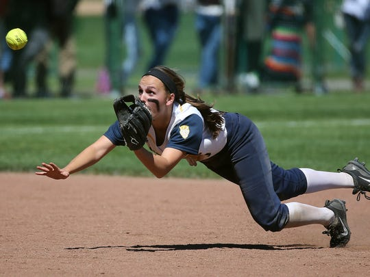 Victor shortstop  Samantha Torlish makes a diving catch