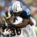 Titans outside linebacker Brian Orakpo stops Rams running back Benny Cunningham during the first quarter at Nissan Stadium on Aug. 23.