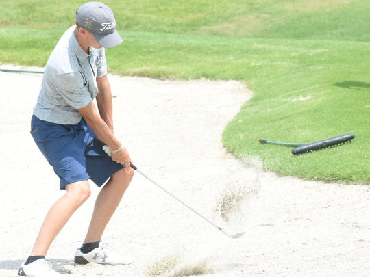 Mountain Home's Bradley Ludwig blasts out of a bunker