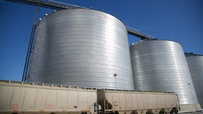 Grain storage bins sit on the edge of the grain ethanol production facility operated by Poet on Feb. 11, 2014, in Emmetsburg.