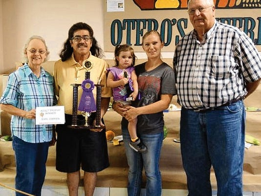 Meet the winners: Alice and Jim Money provided and presented the trophies to the Otero County Fair produce competition winners, Bryssa Teller in the youth category, and Earl O'Brien in the open category.