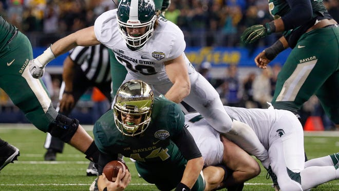 Michigan State Spartans linebacker Riley Bullough sacks Baylor Bears quarterback Bryce Petty during the fourth quarter in the 2015 Cotton Bowl.