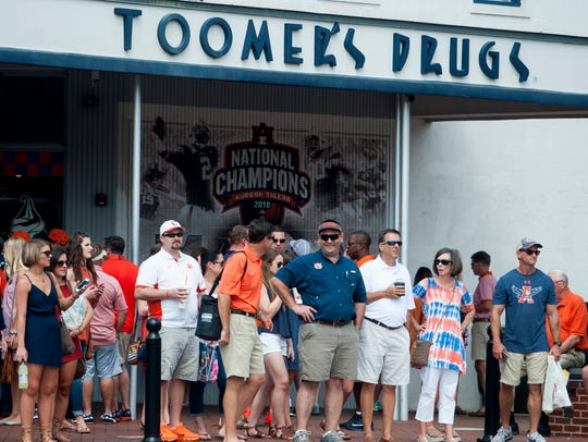 Auburn fans gather at Toomer's Drugs before the Clemson
