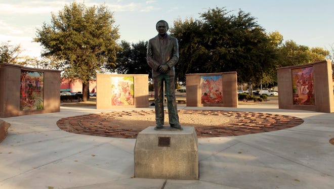 As part of the La Entrada project, the statue of Albert Johnson has been placed near its original location at the park's main entrance at the corner of Picacho Avenue and Main Street.