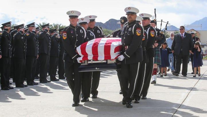 Pallbearers carry the body of Sara Thomas into Southwest