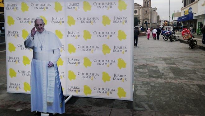 An installation of Pope Francis is shown Jan. 5, 2016, advertising the pope's upcoming visit to Juarez, Mexico.