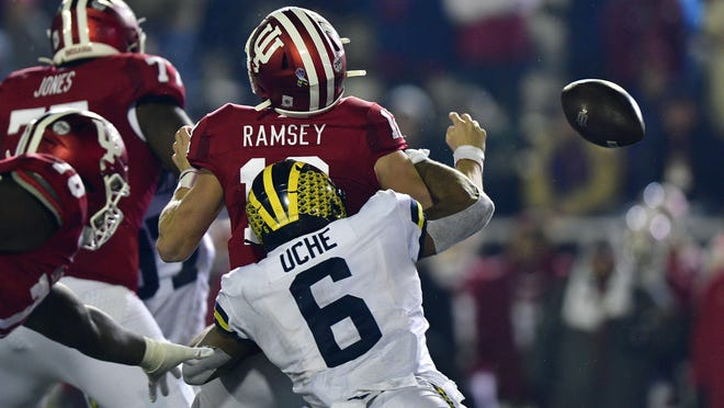 Indiana Hoosiers quarterback Peyton Ramsey is sacked by Michigan Wolverines linebacker Josh Uche.
