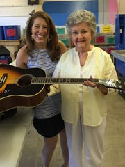 Julie Franklin, right, donated a guitar to the LP Pencil Box in hopes that it could be passed on to a student who would enjoy it. Pencil Box director Kerry Conley said good musical instruments can always find a good home through her organization.