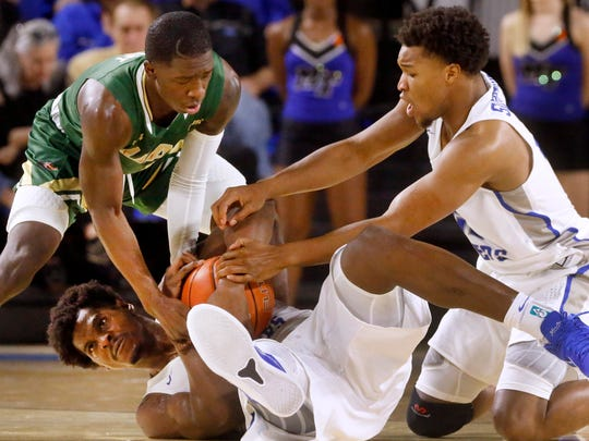 MTSUÕs Brandon Walters (1) and David Simmons (21) fight UAB's Zack Bryant (1) for a loose ball on Saturday, Feb. 24, 2018, at MTSU.