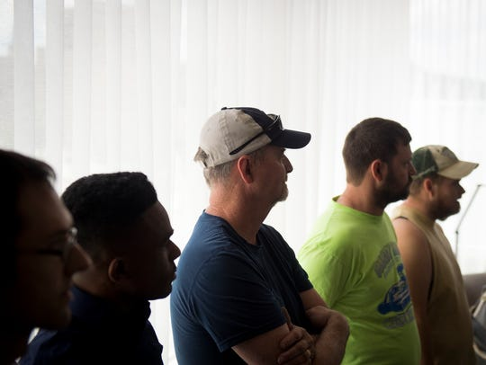 Employees from Hackney Furniture tour the Tennessean
