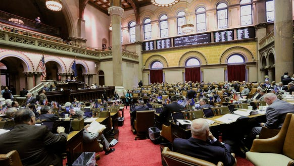 Assembly members wait as members vote and pass the