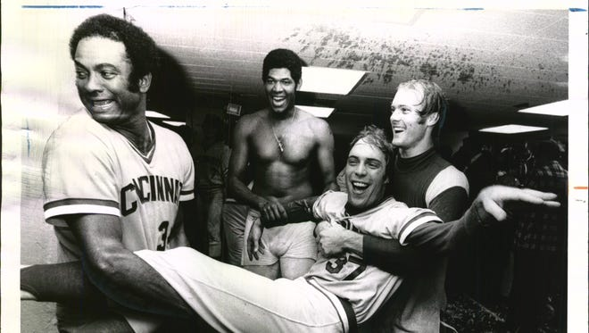 Oct. 23, 1976: Reliever Will McEnaney is off on an escorted trip to the shower in the Reds' clubhouse at Yankee Stadium, hauled in jubilation by Pedro Borbon, left, and Joel Youngblood after the World Series victory over the Yankees. Laughing at the rear is Santo Alcala.