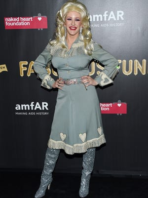 Singer Ellie Goulding transformed in Dolly Parton.
